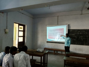 Physics Department Faculty taking class using projector (2)