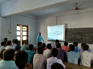 Physics Department Faculty taking class using projector (3)