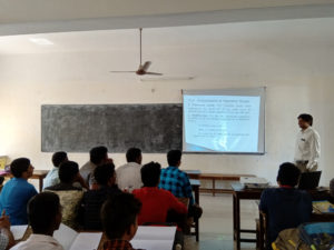 Physics Department Faculty taking class using projector (8)